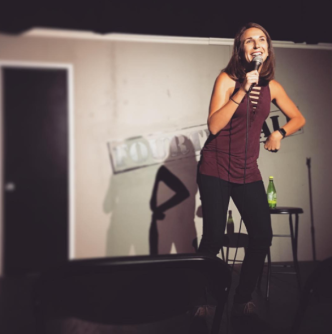 "Kaycee performing at her monthly show ""Inside Jokes"""