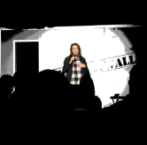 Kaycee performing on her monthly show at The Fourth Wall